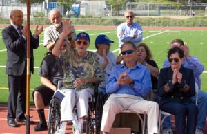 Uni legend Craig Dixon (hand raised) and Mel Patton biographer Larry Booth