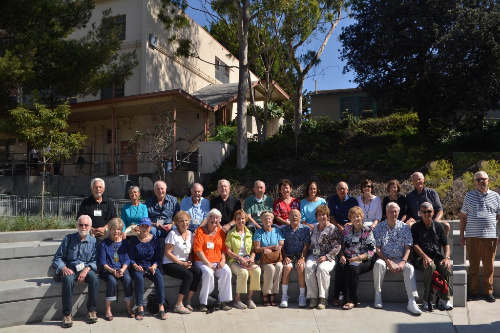 Attendees of the Class of Winter '56 reunion, smiling from the recently-completed Uni amphitheatre, near the Classroom Building. (Photo courtesy Marsha Franks Cohen)