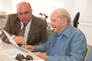"Hal Cunningham, 103, who attended Harding High School in the 1920s, receives an Honorary LAUSD Diploma from ""Harding High School"" from Uni principal Eric Davidson on December 8, 2014"