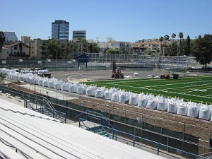 Bags of sand - 105 tons in all - used to help hold the new field in place (Photo courtesy UHEF)