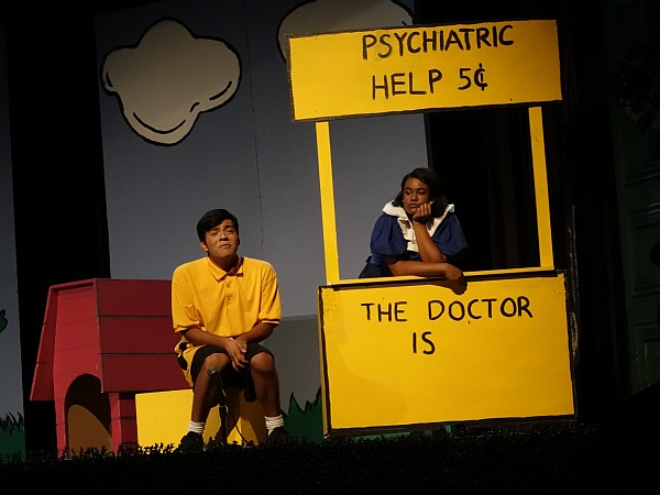 "Andy Santiago as Charlie Brown and Veraliz Cornett as Lucy in ""The Doctor is In."""
